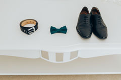 Trendy men`s strap bow tie and shoes. Accesories, close-up. Set groom bow ties, shoes on white background Stock Image