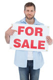 Trendy model holding a for sale sign. Trendy model on white background holding a for sale sign Royalty Free Stock Photos