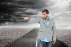 Trendy model pointing to something Royalty Free Stock Image