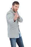 Trendy model posing wearing a blazer. On white background Royalty Free Stock Photo