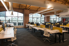 Trendy modern open concept loft office space with big windows, natural light and a layout to encourage collaboration Royalty Free Stock Photography