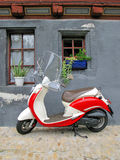 Trendy moped. Against old building. Fribourg, Switzerland Royalty Free Stock Photos