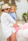 Trendy mother with a baby daughter Royalty Free Stock Images