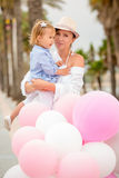 Trendy mother with a baby daughter Stock Photo