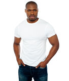Trendy muscular guy posing in style Stock Images