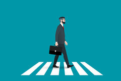 Trendy nerd hipster pedestrian crossing continental crosswalk. This businessman wearing a solid suit and goes forward. Royalty Free Stock Images