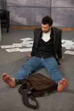 Trendy office worker on floor Royalty Free Stock Images