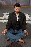 Trendy office worker meditating Stock Photography