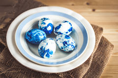 Trendy painted Easter eggs on a plate Royalty Free Stock Photo