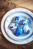 Trendy painted Easter eggs on a plate Royalty Free Stock Images