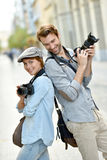 Trendy photographers with camera Royalty Free Stock Photos