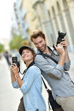 Trendy photographers in the streets Stock Photos