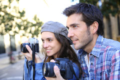 Trendy photogrpahers in town Stock Image