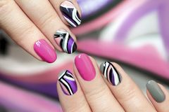 Trendy pink purple nail Polish . stock photography