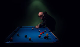 Trendy pool player in a leather jacket Stock Photo