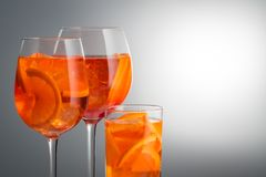 Summer refreshing faintly alcoholic cocktail Aperol spritz in a. Trendy popular Italian drink Summer refreshing faintly alcoholic cocktail Aperol spritz in a stock photo