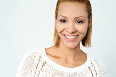 Trendy pretty woman wearing knitted top Royalty Free Stock Images