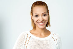 Trendy pretty woman wearing knitted top Stock Photo