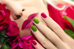 Trendy red green blue manicure and makeup. royalty free stock image