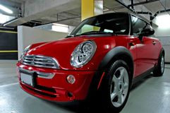 Trendy Red Sports Car. A Trendy Red Mini parked in an underground parkade royalty free stock image
