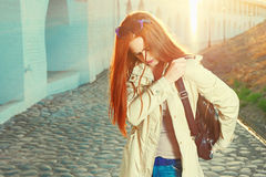 Trendy redhair woman with fashion handbag outdoors Royalty Free Stock Images