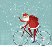 Trendy Santa. Claus riding his bicycle Stock Image