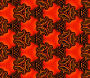 Trendy seamless ornamental pattern of fractal shapes in red, orange, yellow and black shades. Abstract trendy seamless ornamental pattern of fractal shapes in Royalty Free Stock Images