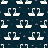 Trendy seamless pattern with white swans in love and water lily on dark blue background. Night lake art background. Fashion design for fabric, wallpaper Royalty Free Stock Images