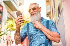 Free Trendy Senior Man Using Smartphone App In Downtown Center Outdoor - Mature Fashion Male Having Fun With New Trends Technology - Royalty Free Stock Image - 174033456