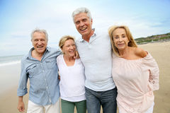 Trendy seniors on the beach walking Royalty Free Stock Photos