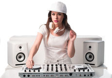 Trendy sexy DJ dressed in white mixing music Royalty Free Stock Photography