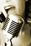 Trendy Singer. Girl Singing In The Retro Microphone Royalty Free Stock Photography