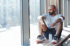 Trendy Sportsman Resting by Window after Workout Stock Image