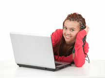 Trendy student girl with laptop Royalty Free Stock Image