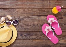 Trendy summer accessories on wooden background Royalty Free Stock Photo