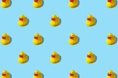 Trendy summer pattern with yellow rubber duck on bright blue background. Minimal summer concept.  vector illustration