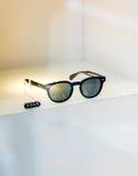 Trendy sunglasses with price tag Stock Photos
