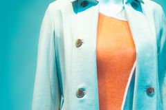 Trendy teal orange color combination in clothes.  stock photo