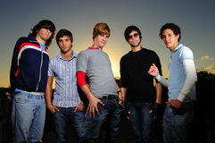 Trendy team of young men. Portrait of young trendy teenager group posing Stock Image