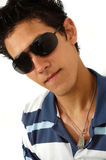 Trendy teen portrait. Portrait of young man wearing sunglasses with attitude Stock Photography