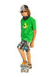 Trendy teen on skateboard Royalty Free Stock Images