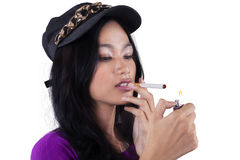 Trendy teenage girl smoking cigarette Stock Images