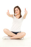 Trendy teenage girl with thumbs up Royalty Free Stock Photos