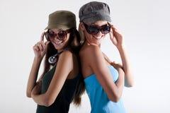 Trendy teenage girls. On white background Stock Photos