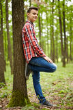 Trendy teenager in the forest Royalty Free Stock Photos