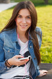 Trendy teenager listening music on smartphone teeth smile Stock Image