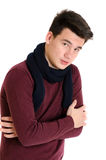 Trendy teenager man in sweater with warm scarf attitude cold iso Stock Photo