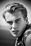 Fashion man portrait. Young blonde guy. Fashion man. Close up of a young blonde guy looking at camera. Black and white portrait Stock Photos
