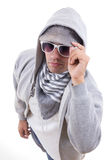 Trendy teenager with style wearing sweatshirt with hood and sung Royalty Free Stock Photos