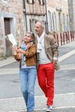 Trendy tourists discovering old city Royalty Free Stock Photo